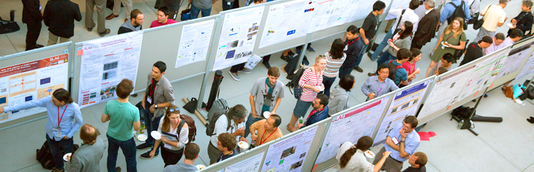 Photo: Researchers displaying their posters